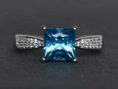 Princess cut blue topaz ring solitaire ring engagement ring 925 sterling silver #Affinity Silver Engagement Rings, Wedding Rings, Wedding Engagement, Paisley, Ideal Cut Diamond, Blue Gemstones, London Blue Topaz, Blue Topaz Ring, Or Rose