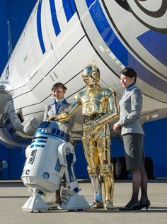 "archatlas: "" Boeing & ANA unveil R2-D2 Dreamliner Star Wars theme music played and Storm Troopers held guard as the hangar doors began to open. Within moments, a Boeing 787 ""Dreamliner"" painted with..."