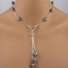 This necklace is made with beautiful black Tahitian baroque cultured pearls that are wire wrapped onto sterling silver chain.  The necklace connects in the center with a focal piece that consists of three chain drops with pearl dangles. BUY NOW http://jewelrybytali.com/products/black-tahitian-baroque-pearl-sterling-silver-necklace-black-cultured-pearl-necklace