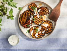 Recipe for: Harissa Grilled Eggplant. Harissa, a Middle-Eastern blend of chilis, garlic, oil, and spices, lends incredible flavor to anything from chicken to veggies to aioli. Here, we slather it over eggplant before grilling, then serve with a tangy herby yogurt sauce.