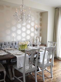 Tone on tone wallpaper    Sarah Richardson Design - ivory and gold floral wallpaper, floor length drapes, gray velvet button tufted banquette,