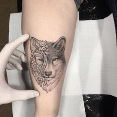 Find the tattoo artist and the perfect inspiration to make your tattoo Tattoo made by Lucas Martinelli from São Paulo Wolf with half face in mandala Foot Tattoos, Body Art Tattoos, Small Tattoos, Sleeve Tattoos, Tatoos, Wolf Tattoos For Women, Tattoo Designs For Women, Wolf Tattoo Design, Geometric Wolf Tattoo