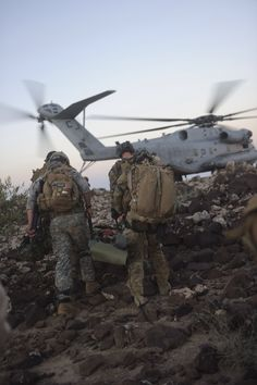 U.S. Air Force pararescuemen with the 82nd Expeditionary Rescue Squadron, and a U.S. Army solider with the Site Security Team/Joint Combat Search and Rescue, 2nd Battalion, 137th Infantry Regiment, evacuate a simulated patient by the CH-53 Sea Stallion in Djibouti, Oct. 20, 2010. The Site Security Team/Joint Combat Search and Rescue and the 82nd ERQS are deployed in support of the Combined Joint Task Force- Horn of Africa mission. (Photo by Senior Airman Christine Clark)