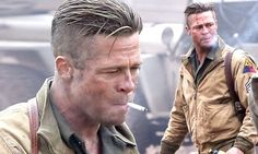 Brad Pitt smokes his way through another day on set of new movie Fury.