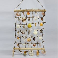 Sea shells wall deco - Bamboo sticks, rope and attached sea shells..