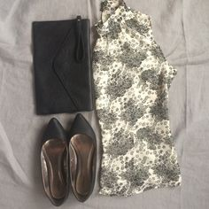 Apt. 9 Sleeveless Blouse Gorgeous black and ivory sleeveless blouse. Perfect with a black pencil skirt and cardigan or bring in a pop of color with some solid colored pants. Second buttonhole is torn but held together with safety pin. 100% polyester. Apt. 9 Tops Blouses