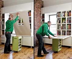 If you need an extra table for dining or work, then this 'fold and roll away' desk could be for you.    Just lower the tabletop to reveal the book cubbies, roll the island into place to support the surface, and you have an instant home office.    Simple and effective. What do you think?