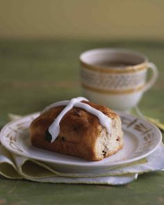Nutmeg-scented hot cross buns are studded with dried cherries and golden raisins. Traditionally served on Good Friday, these yeast-risen buns are delicious before an egg hunt or with a cup of hot tea.
