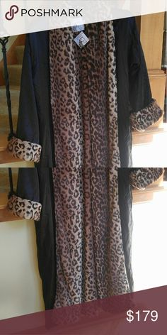Faux fur robe leopard Nwt. Undoubtedly the softest robe you will ever feel. Faux (leopard) fur on the inside and a deep rich espresso satin outside.  No belt.  Giraffe at home, from Nordstroms.  Size small /medium Giraffe at home  Intimates & Sleepwear Robes