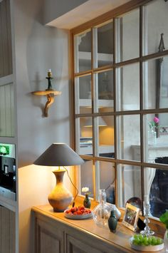 from the home of Greet Lefèvre of the Belgian Pearls blog-love windows inside the house to break up spaces!