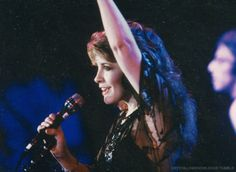 Stevie onstage  ~ ☆♥❤♥☆ ~  waving to audience, wearing her famous beautiful black beaded tunic at the US Festival, 1983