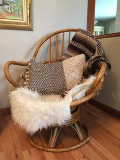 This is a 1960-70s Rattan Swivel/Rocking Chair. Its in excellent condition minus minor damage at base (see photos). Very boho chic, does not come with items pictured. •• SHIPPING ISNT FREE •• This item will be shipping through Greyhound station to door service. Please message me for a quote PRIOR to placing order. Seller is not responsible for damages/fees/shipment delays once it leaves station. I package each item with complete care. •• Return Policy •• There are no returns&...