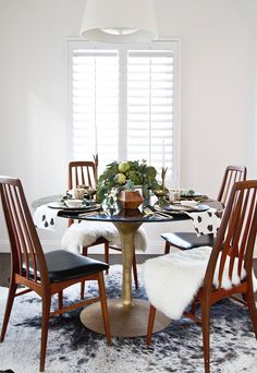 Rustic Thanksgiving table setup in white dining space