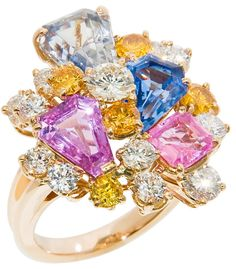 Oscar Heyman for J.E. Caldwell cocktail ring with natural pink and blue ceylon sapphires, and natural yellow and white diamonds totaling 2.50 carats. Via Diamonds in the Library.