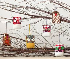 Owls....Bring some colour and personality to your Christmas tree with this set of three sweet handmade birds. Made from beautiful up-cycled wool and vintage fabric with a little felt beaks, these pretty birdies are all unique and therefore may differ slightly in detail from the photos. Handmade in Cambridge. Size: 6cm tall Your birds will come beautifully wrapped in brown paper packaging tied up with string.