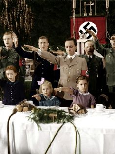Photo of Geobs face and his kids and wife giving the Hitler Salute.