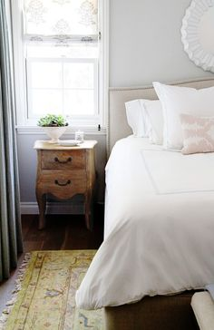 such a cute little side table and bedding!.