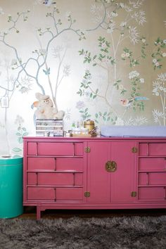 Lacquered mid-century Asian-inspired dresser with AMAZING De Gournay hand-painted metallic silk wallpaper. The post A Modern Glam Nursery Makeover Shop The Look appeared first on Children's Room. Pink Dresser, Nursery Dresser, Commode Rose, Childrens Room, Hand Painted Wallpaper, Silk Wallpaper, Oriental Wallpaper, Trendy Wallpaper, Consoles