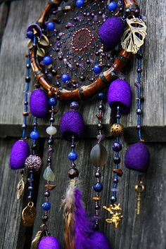 Dreamcatchers: Beautiful Vibrant Dreamcatcher with Bamboo Wood Ring, Gold Charms, Beads ad Purple Cone Embellishments | #Dreamcatchers #Dreamcatcher
