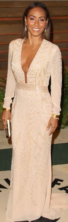 Who made  Jada Pinkett Smith's nude long sleeve plunging gown that she wore in West Hollywood on March 2, 2014?