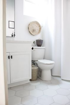 Next on the house tour is our guest bathroom. A labor of love completed in just a six week makeover with new tile, vanity, paint, and decor. Guest Bathrooms, Bathroom Renos, Dream Bathrooms, Bathroom Renovations, Bathroom Interior, Small Bathroom, Master Bathroom, Bathroom Ideas, Ikea Bathroom