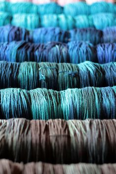 Completely drool-worthy: newly dyed Tanis Fiber Arts yarn drying on racks.
