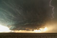 Supercell cumulonimbus with rotating wall cloud near Booker, Texas on June 3, 2013. Captured by Mike Olbinski.