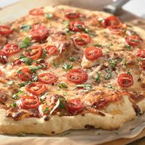 Classic Pizza Margherita///Classic Margherita-style pizza is the most basic of all pizzas but so delicious if you use good ingredients: a nice olive oil, ripe juicy tomatoes, good mozzarella cheese and fresh basil.  Recipe courtesy of King Arthur Flour.