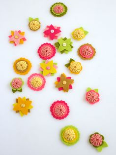 I got the pattern for these on Purl Bee, and I've already made a few. Cute and easy!    http://www.purlbee.com/felt-flower-charms/