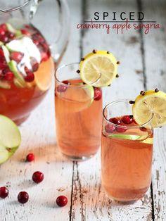 Spiced Cranberry Apple Sangria, a delicious fall or Thanksgiving sangria! Thanksgiving Sangria, Holiday Sangria, Holiday Drinks, Fun Drinks, Yummy Drinks, Thanksgiving Recipes, Beverages, Cranberry Apple Juice, Cranberry Sangria