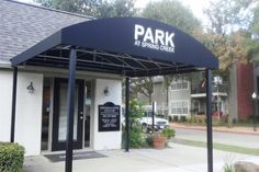Front view of the canopy at Park at Spring Creek Apartments. That is some good shading right there! I am sure this helps when you are trying to get to the office and it's raining.