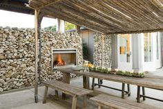 outside patio with cover, rock cage wall