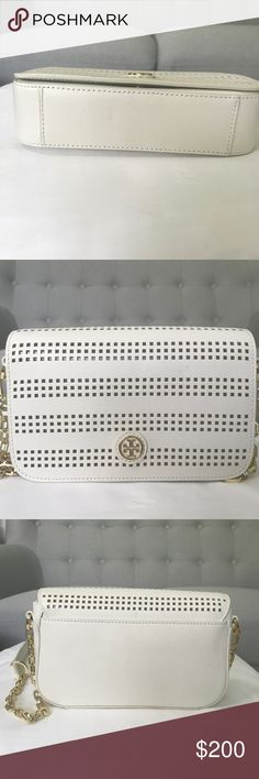 Tory Burch Crossbody bag. Great condition just a few Mark barely see it. Come with dust bag Tory Burch Bags Crossbody Bags