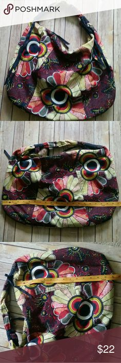 Large colorful hobo bag Large cotton hobo bag in brightly colored floral pattern. Lined. Zipper closure. Dark blue fabric tassels on zipper and strap. Light wear. Good condition. Bags Hobos
