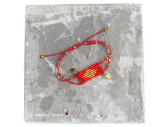 bright red and gold woven micro macrame and by NatachaFayard