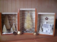 Christmasy shadow boxes, these look like small cigar boxes were used.