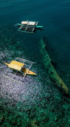 EPIC Drone views of two banaca boats over Lusong Gunboat Shipwreck in the Philippines by the Divergent Travelers Adventure Travel Blog. Northern Palawan is world renowned for it's abundance of WWII shipwrecks. Most of them are accessible for diving and some are even accessible to snorkelers. Click to see all of the Amazing Drone Photos of the Philippines at http://www.divergenttravelers.com/drone-photos-of-the-philippines/