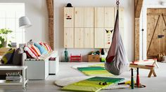 Single behind couch with bench seating and additional pillows.IKEA Catalog 2015  Playroom with hanging chairs, storage bench and play mats