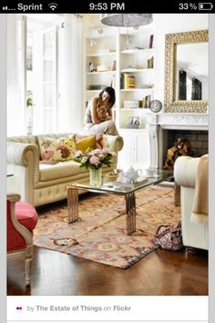 Light Chesterfield and white walls. accent colors derived from chairs, rug and pillows.