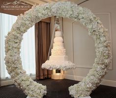 Halo hanging wedding cake with each tier a different shape! We absolutely love this unique statement cake!