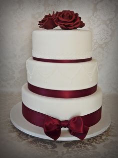 Three tier fondant wedding cake Royal blue and white with bling