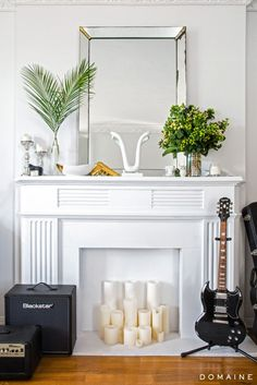 Exclusive: Tour Margo & Me's Hollywood Haven | DomaineHome.com // A cluster of candles are a lovely touch inside a fireplace.
