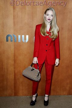 American actress, singer-songwriter, and model, Amanda Seyfried attended the 2013 Spring/Summer Miu Miu fashion show during Paris Fashion Week toting new season Prada tote. Prada Mary Jane Pumps in purple were the order of the day footwear. Amanda wore a gorgeous all red Prada jacket and pants suit from the Resort 2013 Collection.    *courtesy of Delortae Agency luxury authentic handbag SPA, visit us on Facebook; www.facebook.com/DelortaeAgency