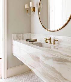 Loving the simplicity of this elegant marble bathroom with gold accents #interiordesign #marblebathroom #robertelliottcustomhomes