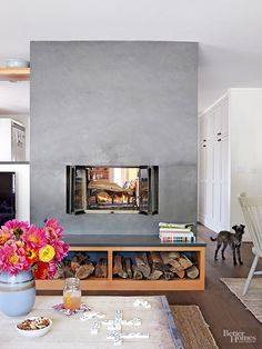 Cladding the dated fireplace in slate gave it a much-deserved facelift. It delineates the living and dining areas from the kitchen and warms both spaces. Consistent materials -- wood, slate, and natural textiles -- make the house feel unified and create easy flow.
