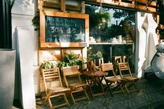 a coffee shop with ceramic things named Bazaar on Vo Thi Sau street, district 3, Ho Chi Minh city. this is its outside with couples of small table and chairs. (minolta x700, min 28-70, fuji proplus 200). #filmphoto #vietnam