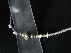 Hand made bracelet made of pearls,mourano flowers, amethyst and silver 925 ball.Made by Eirini Svarnia.Price 35.00 euro