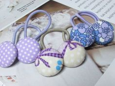 Check out this item in my Etsy shop https://www.etsy.com/listing/245695519/button-ponytail-holders-purple-ponytail