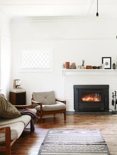 fireplace, clean white walls, chair