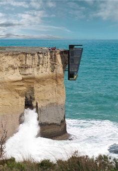 This house is called…Cliff House. It was designed by Australian architects Modscape.   Here's A House Just Casually Hanging Out On The Edge Of A Cliff